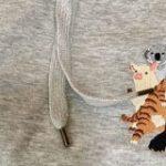 動物がチューチュートレインしてるこの服、それだけでもかわいいのに裏面見たらもう買うしかないやつだった – Togetter